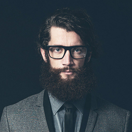Young man with a beard and glasses